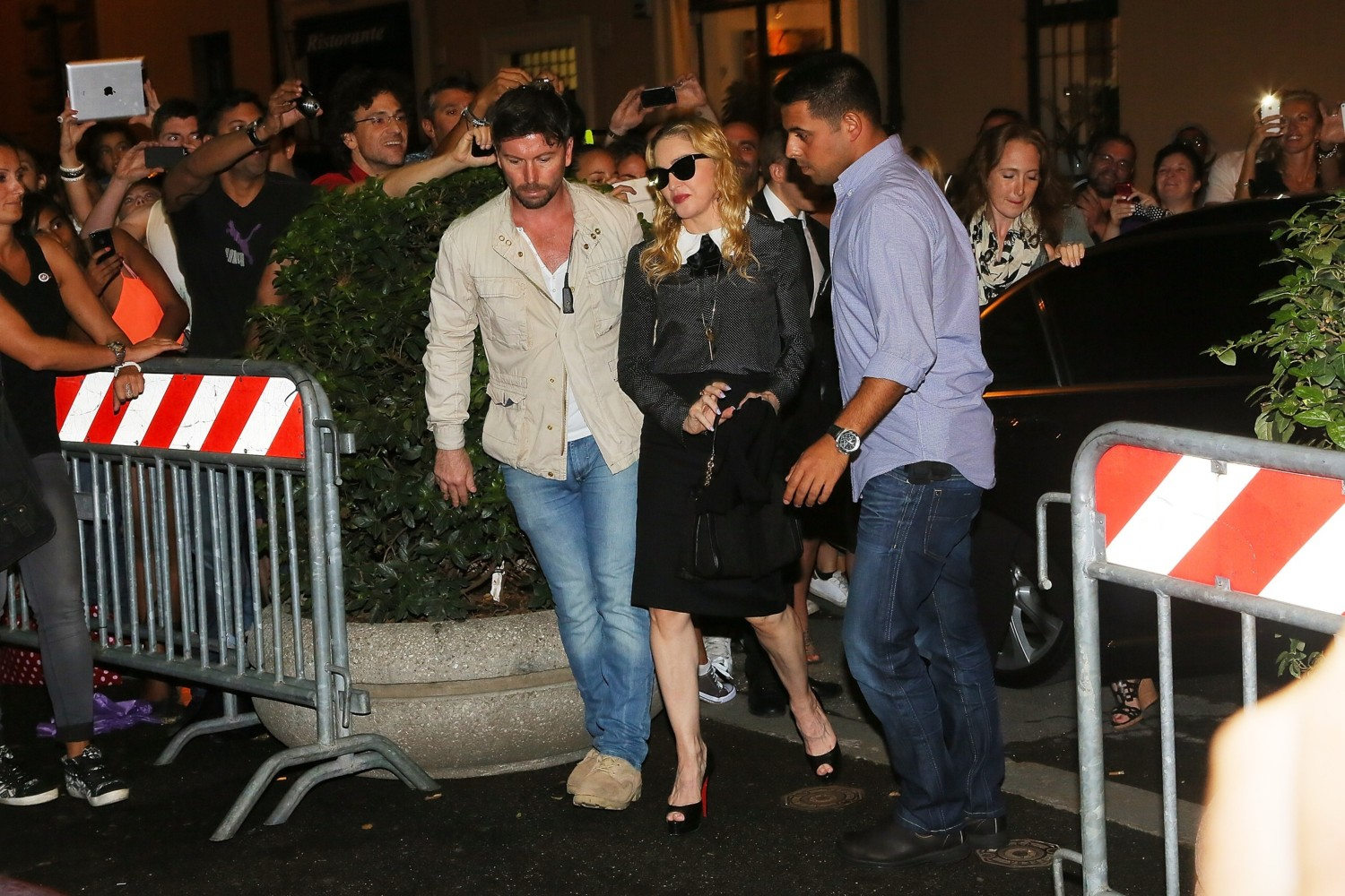 20130821-pictures-madonna-hard-candy-fitness-center-rome-05